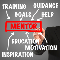Male hand in business wear holding a thick pen, writing on an imaginary screen at the camera: Elements of being a mentor