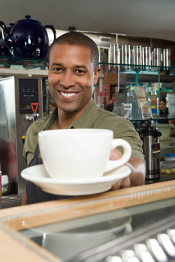 Waiter passing coffee cup