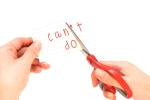 Female using scissors to remove the word can't to read I can do it concept for self belief, positive attitude and motivation