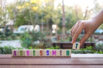 Assessment , Hand and Word with Alphabet Blocks