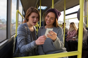 Two teen girls on the bus