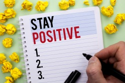Writing note showing  Stay Positive. Business photo showcasing Be Optimistic Motivated Good Attitude Inspired Hopeful written By Man Holding Marker on Notebook Book.