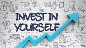Invest In Yourself Drawn on White Brick Wall. 3D