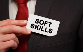Businessman putting a card with text Soft Skills in the pocket