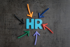 Colorful arrows pointing to the word HR at the center on black cement blackboard wall, represent Human Resource department, hiring new job or position in company