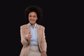 Business woman holding thumb up