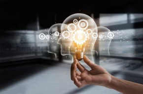 Hand holding light bulb and cog inside. Idea and imagination. Creative and inspiration. Innovation gears icon with network connection on human heads on metal texture background. Innovative technology in science and industrial concept