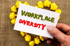 Handwritten text sign showing Workplace Diversity. Conceptual photo Corporate Culture Global Concept For Disability written on Sticky Note Paper With Heart Holding Hand with Finger.