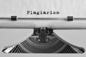 Plagiarism typed on an old typewriter.