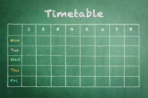 School timetable on green chalkboard background