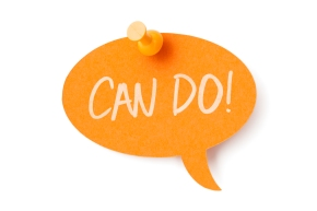 CAN DO on orange speech bubble pinned to white surface